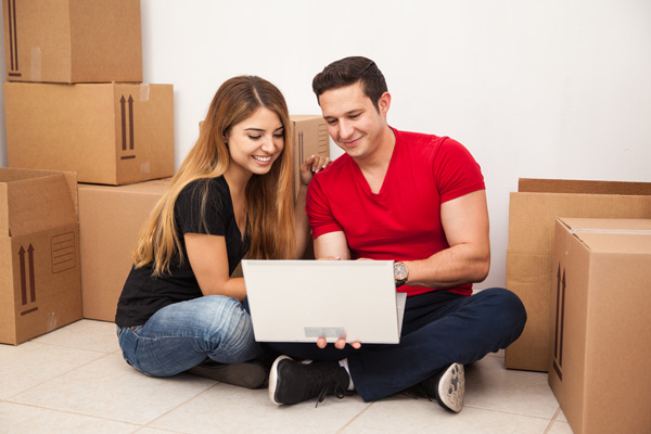 photo of a couple buying moving boxes online