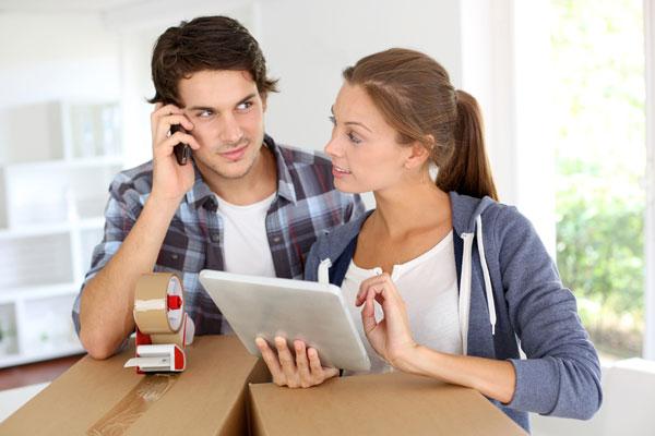 couple calling a moving company