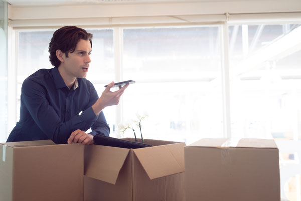 photo of a person calling a moving company