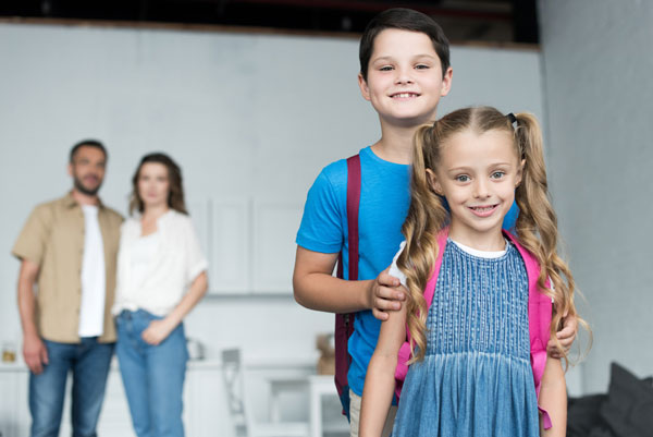 photo of kids going to new school after relocation