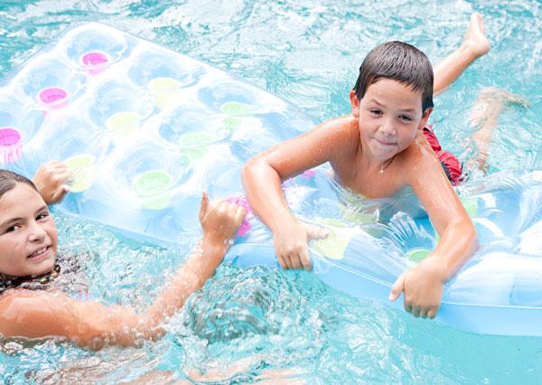 photo of kids enjoying in pool