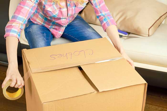 Pack clothes for moving
